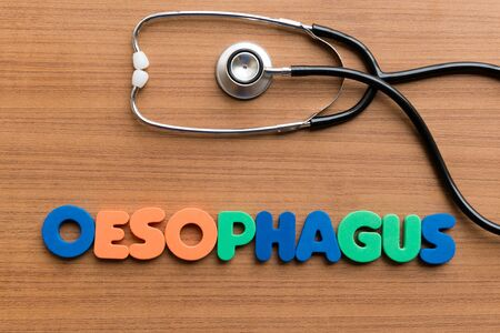 gullet: oesophagus colorful word on the wooden background