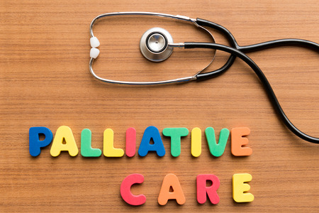medium group of objects: palliative care colorful word on the wooden background