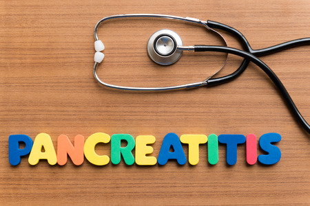 medium group of objects: pancreatitis colorful word on the wooden background