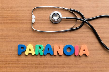 paranoia: paranoia colorful word on the wooden background Stock Photo
