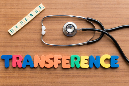 transference: colorful word on the wooden background