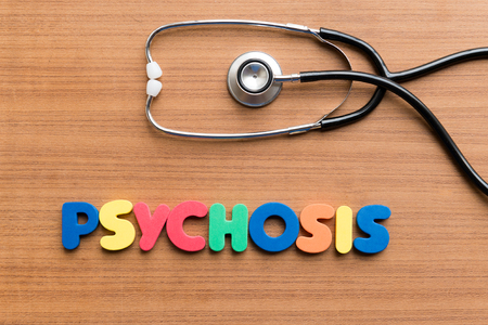 psychosis: psychosis colorful word on the wooden background