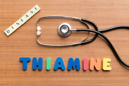 thiamine: colorful word on the wooden background