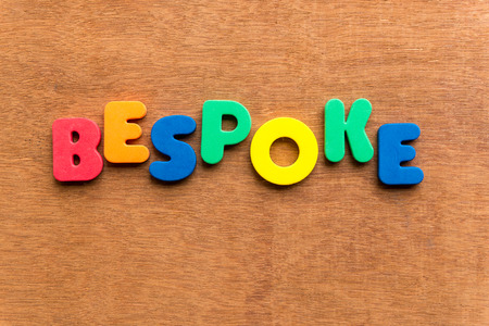 made to measure: bespoke colorful word on the wooden background Stock Photo