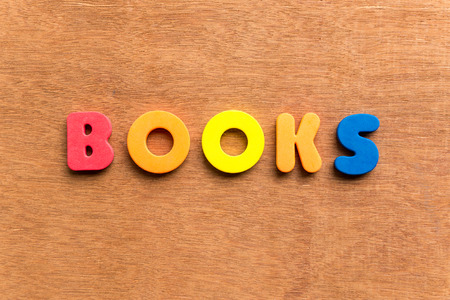 child s block: books colorful word on the wooden background