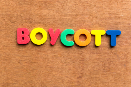 boycott: boycott colorful word on the wooden background