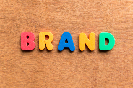 branded product: brand colorful word on the wooden background