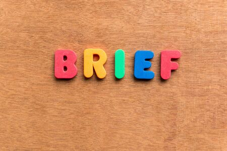 brief: brief colorful word on the wooden background