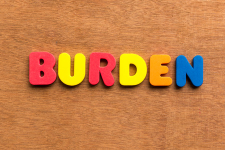 slain: burden colorful word on the wooden background Stock Photo