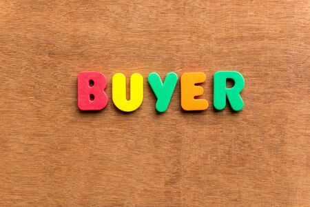 hintergrund: buyer colorful word on the wooden background