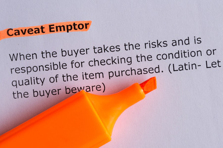 caveat emptor word highlighted on the white paper 版權商用圖片