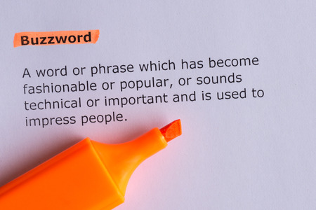 buzzword: buzzword word highlighted on the white paper