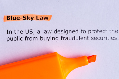 fraudulent: blue sky law word highlighted on the white paper Stock Photo