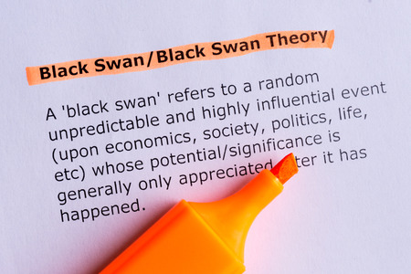 black swan word highlighted on the white paper