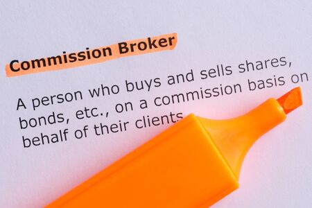 commision: commission broker word highlighted on the white paper