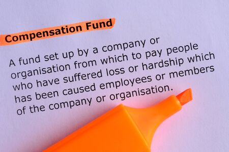 white fund: compensation fund word highlighted on the white paper