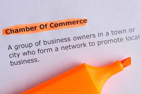 chamber of commerce word highlighted on the white paper