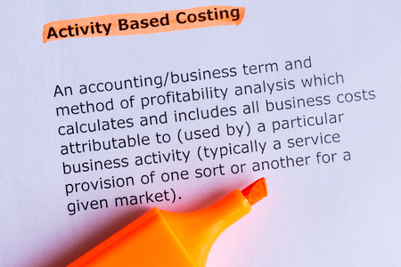 based: activity based costing word highlighted on the white paper