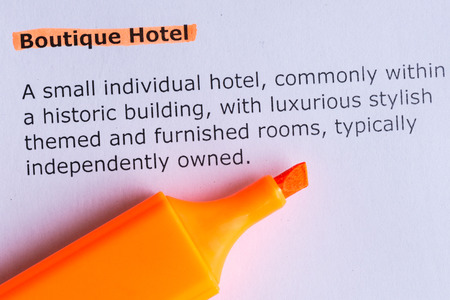 boutique hotel: boutique hotel word highlighted on the white paper