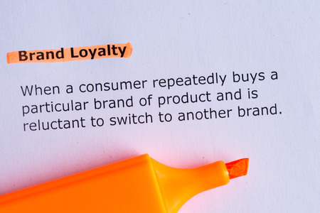 brand loyalty word highlighted on the white paper Stock Photo - 39507101