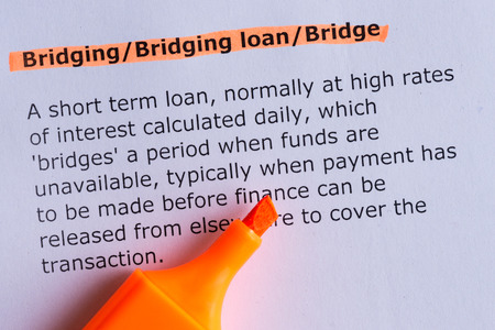 bridging: bridging word highlighted on the white paper Stock Photo