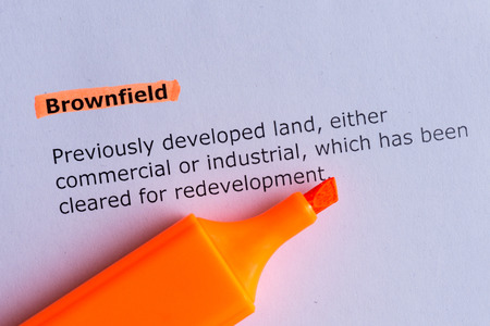 brownfield word highlighted on the white paper