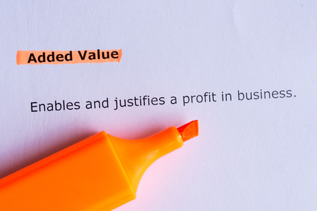 added: added value word highlighted on the white paper Stock Photo