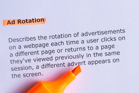 ad: ad rotation word highlighted on the white paper