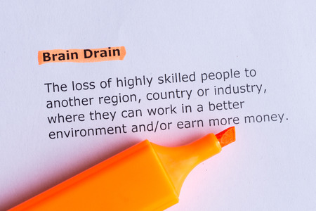 brain drain word highlighted on the white paper