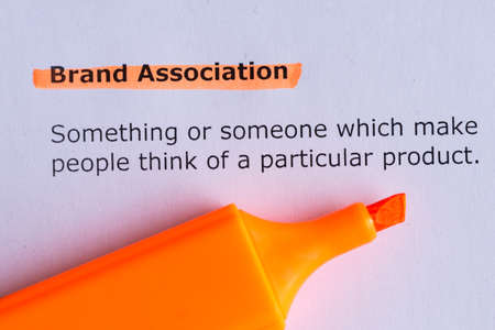association: brand association word highlighted on the white paper