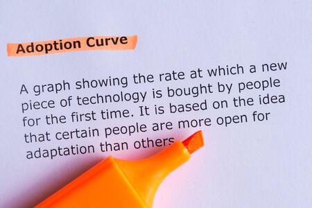 adoption: adoption curve word highlighted on the white paper Stock Photo