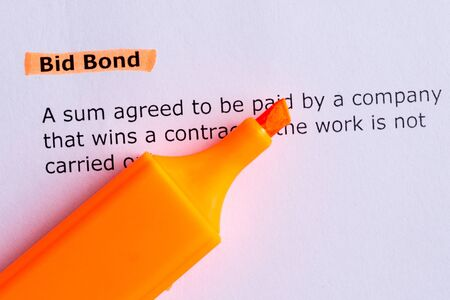 bid: bid bond word highlighted on the white paper