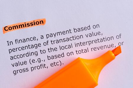 commision: commission word highlighted on the white paper