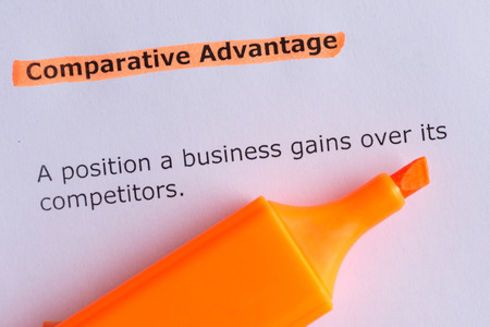 comparative: comparative advantage word highlighted on the white paper