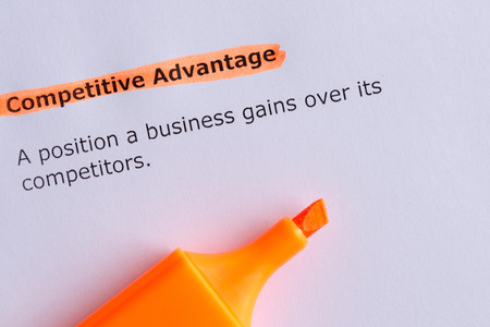 competitive advantage: competitive advantage word highlighted on the white paper Stock Photo