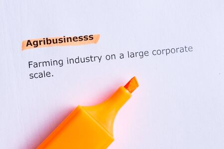 agribusiness: agribusiness  word highlighted  on the white paper