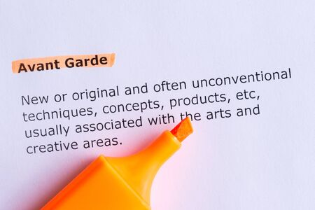 avant garde: avant garde  word highlighted  on the white paper