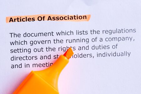 articles: articles of association  word highlighted  on the white paper