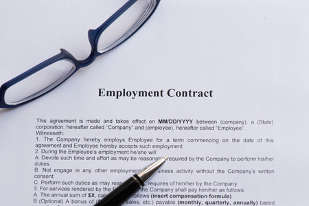 employment contract on the white paper with pen