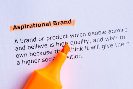 aspirational: aspirational brand  word highlighted  on the white paper