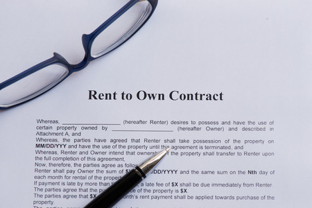 rent to own contract  on the white paper with pen