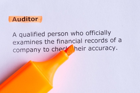 auditor: auditor  word highlighted  on the white paper