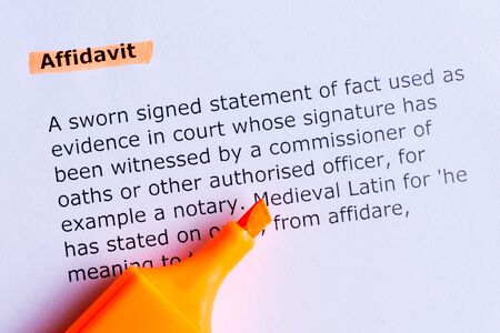 affidavit word highlighted  on the white paper photo
