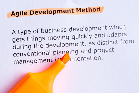 agile development method  word highlighted  on the white paper