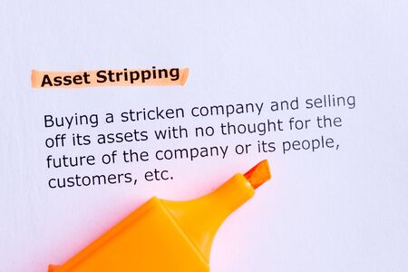 stripping: asset stripping  word highlighted  on the white paper