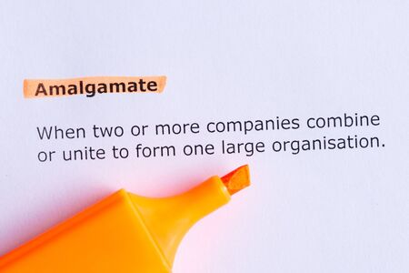 amalgamate: amalgamate  word highlighted  on the white paper Stock Photo