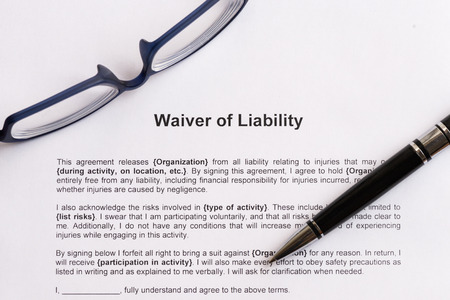liability: waiver of liability  on the white paper with pen