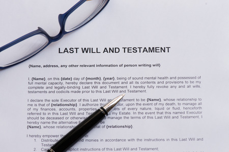 testament: last will and testament  on the white paper with pen