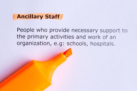 ancillary staff  word highlighted  on the white paper photo