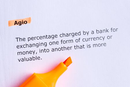 agio  word highlighted  on the white paper photo